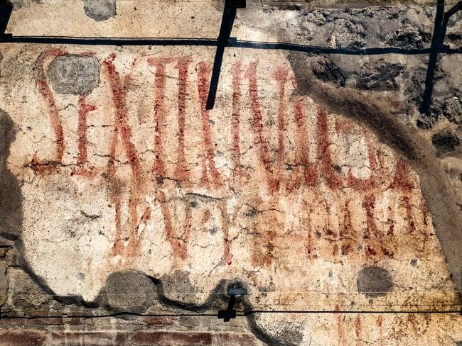 cartel publicitario en pompeya